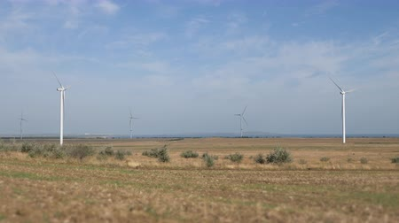Work of the group of wind power. Wind power generator installed in the field. Stock Footage