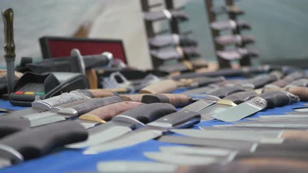 dourado : Knives on blue cloth. Cutting items are laid out. Handmade knives. Vídeos