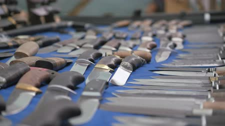 медь : Knives on blue cloth. Cutting items are laid out. Handmade knives. Стоковые видеозаписи