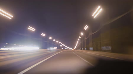 lacuna : Highway hyperlapse. Defocusing flashlights cars traveling on the road.
