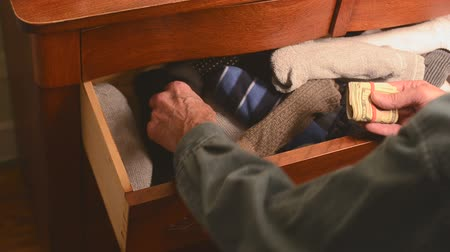 cash hidden in sock drawer