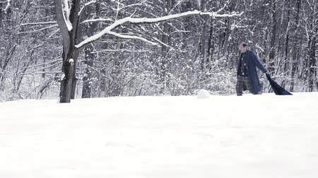 man with dementia walking on snow