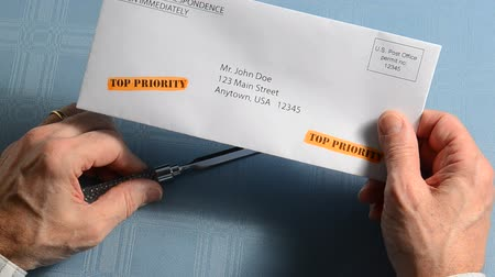 man holding top priority letter