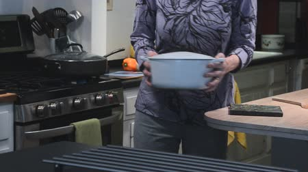 woman with back pain in kitchen