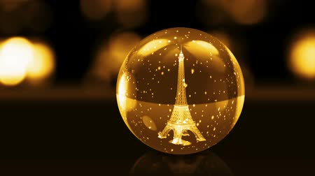 francja : Eiffel Tower in golden glass ball with snow