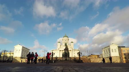 senate square : HELSINKI, FINLAND - DECEMBER 25, 2015: People enjoy a sunny day in the Senate Square in Helsinki on Merry Christmas, Finland. Stock Footage