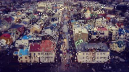 hallgrimskirkja : Reykjavik downtown aerial, Iceland in winter time, view through the glass with raindrops from Hallgrimskirkja
