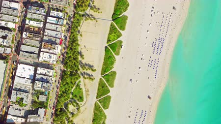 area of port : aerial birds eye view of surfer in tropical clear water miami beach