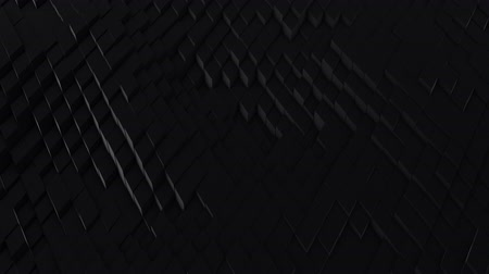 undulating : A lot of black rhombuses on the surface of the whole screen, volumetric wave-like movement of rhombs densely adjacent to each other, slow motion 4K abstract background