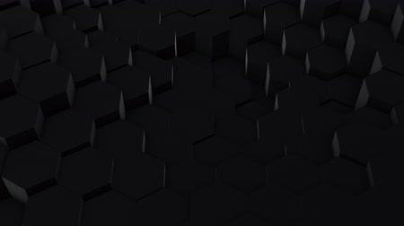 undulating : A lot of black hexagons on the surface of the whole screen, volumetric wave-like movement of rhombs densely adjacent to each other, slow motion 4K abstract background Stock Footage