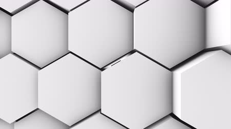 hexágono : A lot of white hexagons on the surface of the whole screen, volumetric wave-like movement of rhombs densely adjacent to each other, slow motion 4K abstract background