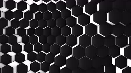плотно : A lot of black hexagons on the surface of the whole screen, volumetric wave-like movement of rhombs densely adjacent to each other, slow motion 4K abstract background Стоковые видеозаписи