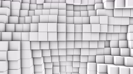 quadrate : A lot of white cubes on the surface of the whole screen, volumetric wave-like movement of cubes densely adjacent to each other, slow motion 4K abstract background
