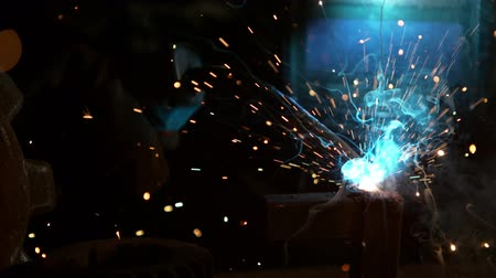 welding helmet : Welder is welding metal part in factory Stock Footage