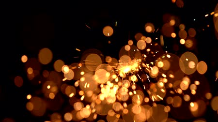 jiskry : Abstract background with shining bokeh sparkles.