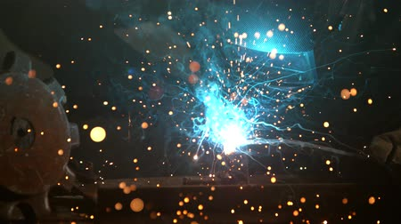 skillful : Welder is welding metal part in factory Stock Footage