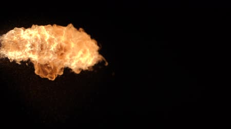 爆弾 : Fire ball explosion, high speed camera, isolated fire flame on black background.