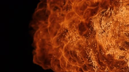 meggyullad : Fire ball explosion, high speed camera, isolated fire flame on black background.