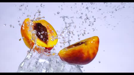 manga : Fresh nectarines fruits fall into the water