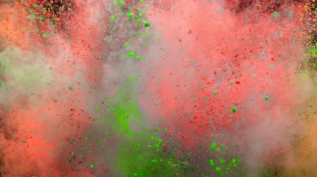 crush : Colorful powder exploding on black background in super slow motion.