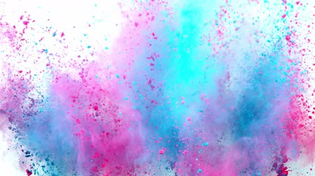 maciço : Colorful powder exploding on white background in super slow motion.