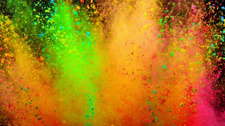 maciço : Colorful powder exploding on black background in super slow motion.