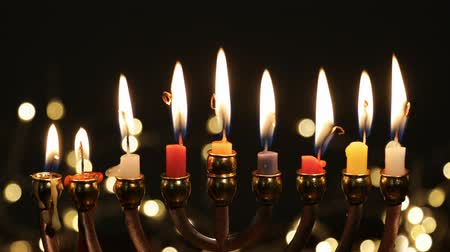 menorah : Hanukah candles celebrating the Jewish holiday Stock Footage