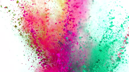 schiacciare : Colorful powder exploding on white background in super slow motion.