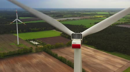 clean electricity production : Wind power turbines - Sustainable, renewable energy concept.
