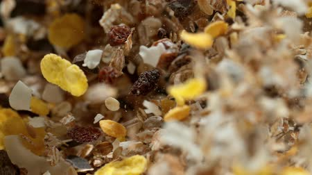 oat flakes : Super slow motion of flying cereal muesli pieces. Filmed on high speed cinema camera,