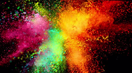 爆弾 : Colorful powder exploding on black background in super slow motion.