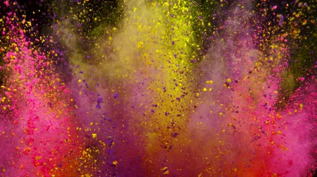 pirotecnia : Colorful powder exploding on black background in super slow motion.
