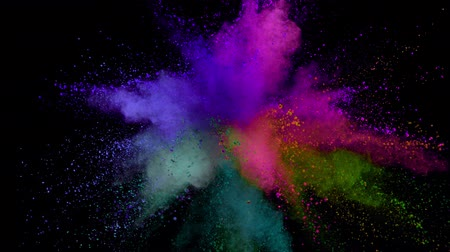 вспышка : Colorful powder exploding on black background in super slow motion.