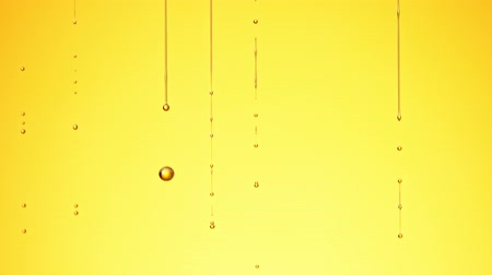 Super Slow Motion Shot of Dripping Oil on Golden Background. Vídeos