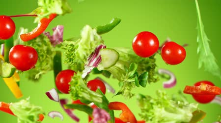 rajčata : Super Slow Motion Shot of Flying Fresh Vegetables