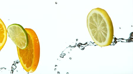 vitamina : Fresh Fruit Slices Falling with Water Splash Cascade in Super Slow Motion
