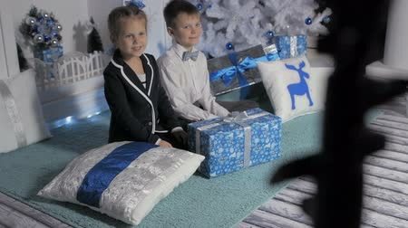 special unit : Children with gifts at Christmas tree Stock Footage