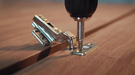 fasteners : Manufacture assembly of furniture, installation of a canopy, twisting of a screw Stock Footage
