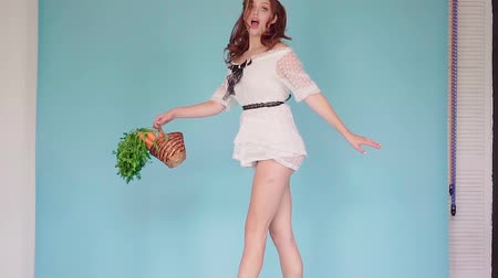 The red-haired girl in a white short dress and with a creative ears of a rabbit Dostupné videozáznamy