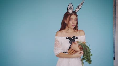 Girl in the image of stylish, fabulous rabbit with love hugs carrot.