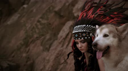 волк : A beauty girl is a Native American walks with a wild wolf. Alaskan Malamute