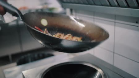 vegetable wok : chef fries food in a wok pan Stock Footage