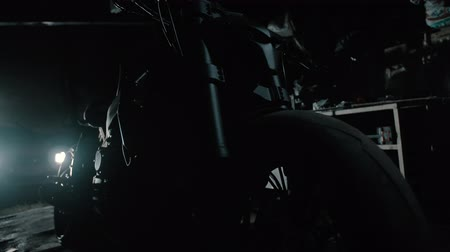 kinetik : black motorcycle silhouette in garage ghostbike 2 Stok Video