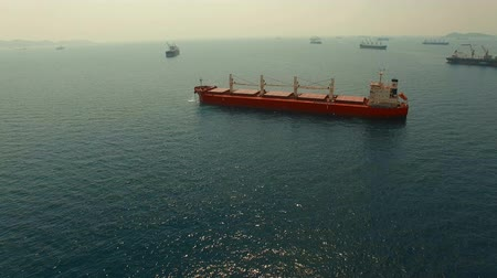 importação : aerial view of container ship approaching to industry port harbor for import and export commercial
