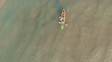 eco tourism : people kayaking over sea water