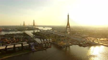 aerial view of bhumipol1,2 bridge important transportation bridge crossing chaopraya river and construction landmark in heart of bangkok thailand capital Стоковые видеозаписи