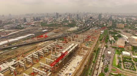 infra : aerial view of mega project sky trains and land transportation construction site in heart of capital Stock Footage