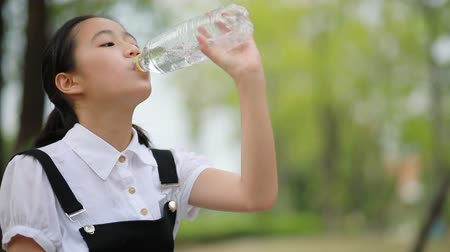 asian teenager drinking water
