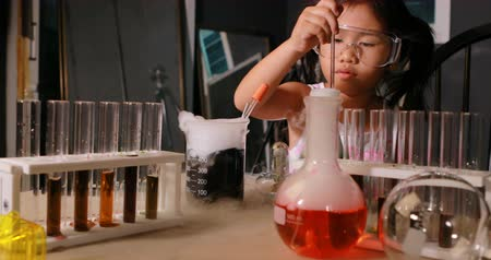 asian children examination in science laboratory Стоковые видеозаписи