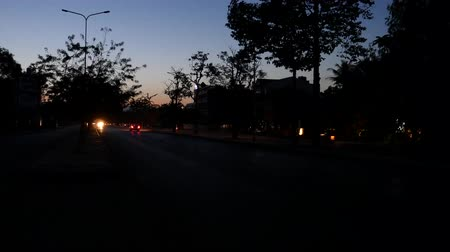 six worlds : Siem Reap, Cambodia-December 22, 2017: It is around 6AM. Traffic of National Road No6 in Siem Reap is still smooth.